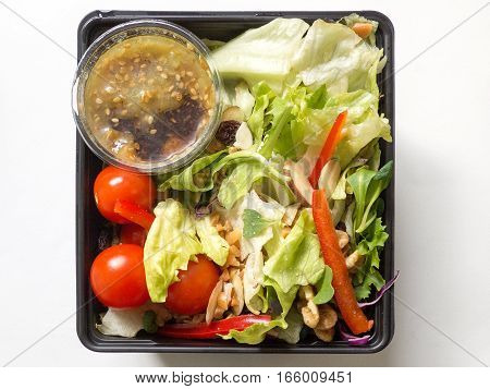Fresh vegatable salad in a plastic package, isolated on white background