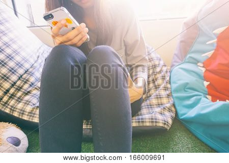 Woman Typing Text Message On Smart Phone In A Cafe