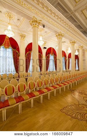 KAZAN, RUSSIA - 16 JANUARY 2017, City Hall - luxury and beautiful touristic place - a row of chairs in golden ballroom, wide angle