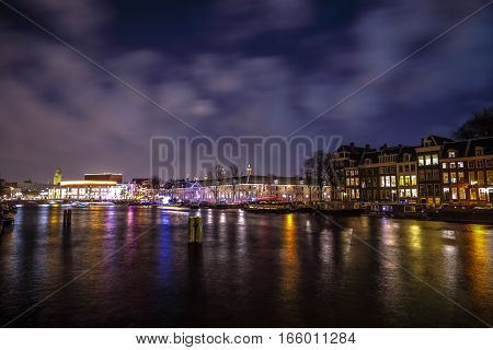 AMSTERDAM NETHERLANDS - JANUARY 12 2017: Beautiful night city canals of Amsterdam. January 12 2017 in Amsterdam - Netherland.
