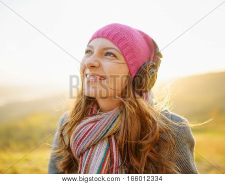 Young Woman Enjoying A Music In The Fall Season. Autumn Outdoor Portrait