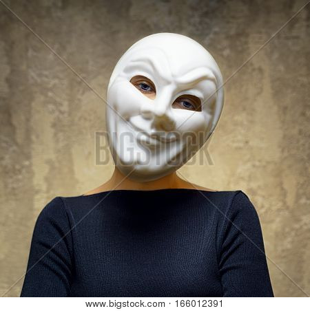 Woman in white mask. Concept of horror.