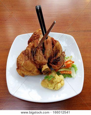 German Pork Hocks - Deep fried pork knuckle served with mashed potatoes.