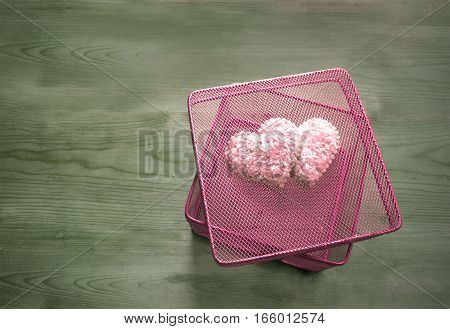 Valentine's day concept. Pink gift box with hearts on wooden vintage background