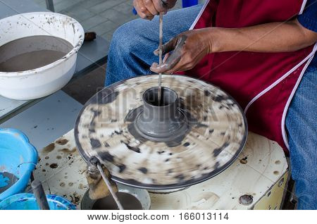 Asia Man Make Earthenware from Grey Clay at Thailand