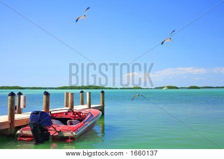Boat At Dock In The Bay