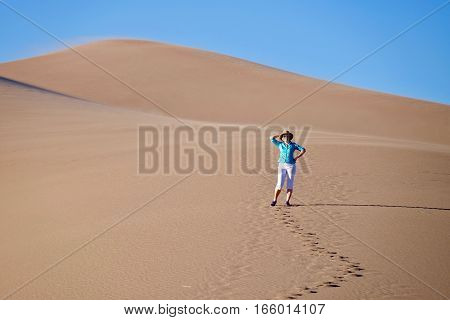 Woman hiking in Great Sand Dunes National Park and Preserve. Denver. San Luis Valley. Alamosa Saguache County Colorado. United States.
