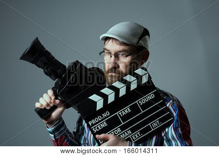 Man Retro Movie Camera And Clapper