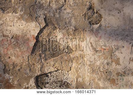 The texture of the old walls, cracked and fading. Background.