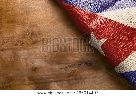 Flag of Cuba state on a wooden background.