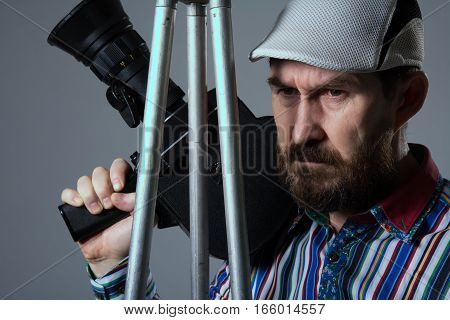 Bearded Man Movie Camera Tripod