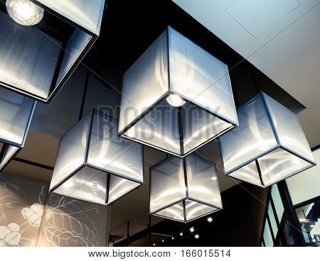 Light colored triangles adorn the restaurant a modern lighting aesthetic.