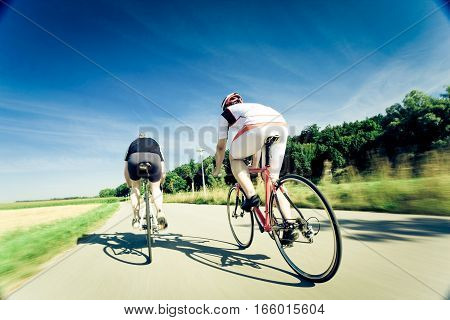 racing cyclists, motion blur on wheels and ground