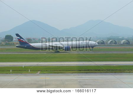 HANOI, VIETNAM - JANUARY 12, 2016: Contact point. The Russian Boeing 777-3M0 (VP-BGC) of the Aeroflot company makes landing at the airport of Noybay. Hanoi Vietnam