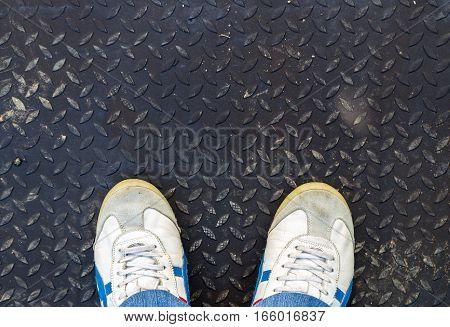 Man Sneaker On Metal Diamond Grip Floor