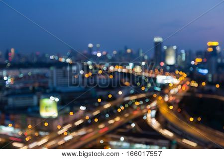 Blurred lights Highway intersection with city downtown background night view