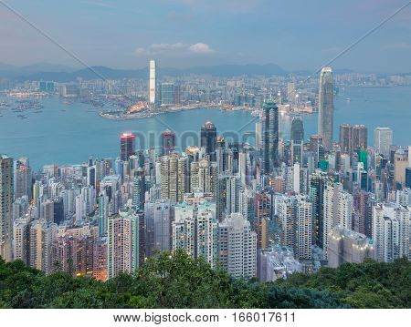Aerial view Hong Kong office building over Victoria Bay at twilight form the peak point view