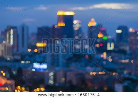 Blurred light cityscape downtown at twilight sky background