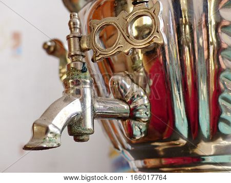 Crane samovar closeup. Retro. Russian traditional suvenir. Folk craft.