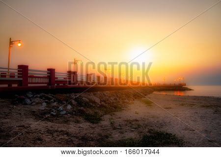 Beautiful sunrise sky at Saran Witee Bridge Prachuap Khiri Khan province Thailand