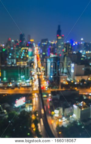 Top view blurred bokeh lights city cross road night view abstract background