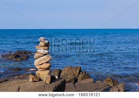 Stack stone over seacoast skyline natural abstract background