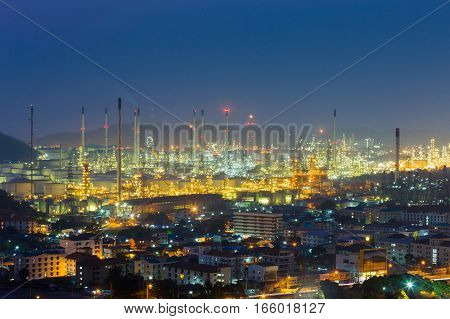 Refinery lights night view with mountain background industrial landscape background
