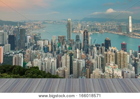 Opening wooden floor Hong Kong central business downtown over Victoria Bay skyline