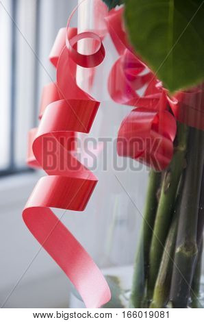 Red serpentine on holiday bouquet. Gift and present