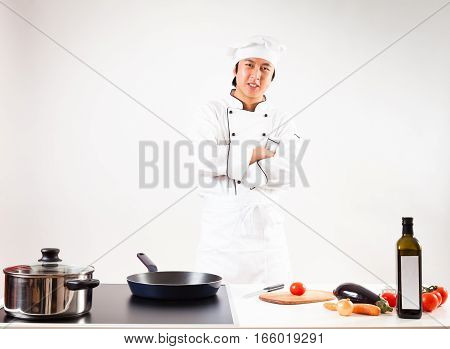 Studio shot of chef cooking in his kitchen