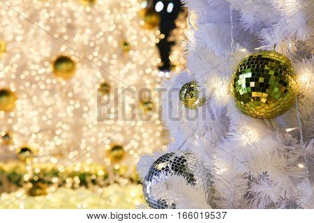 Beautiful gold glass ball with lights on Christmas Tree,happy new year.