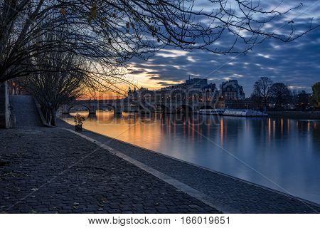 Sunrise on the Seine River banks (Quai des Tuilleries) and Ile de la Cite. 1st Arrondissement Paris France