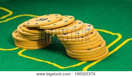 poker chips lined the bridge in the background, a green leaf