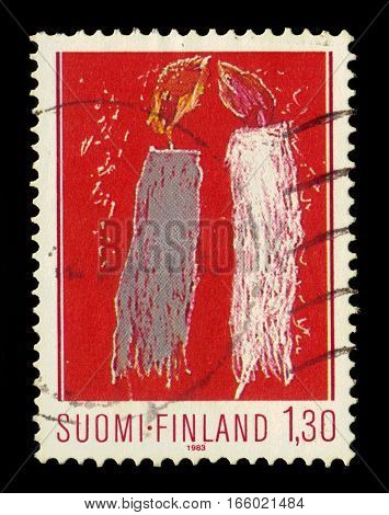 FINLAND - CIRCA 1983: a stamp printed in Finland shows child drawing: christmas candles, series Christmas, circa 1983