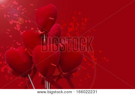 Red velvet hearts on red background with small hearts confetti