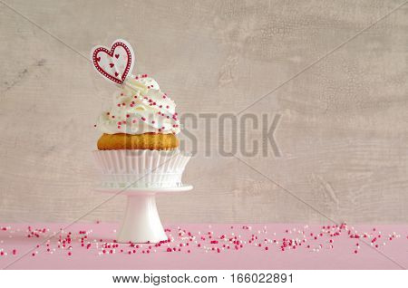 homemade birthday cake with whipping cream and heart