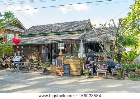 MAE HONG SON, THAILAND - JAN 2, 2017: Many people eating some food in the small restaurant in Pai, Thailand