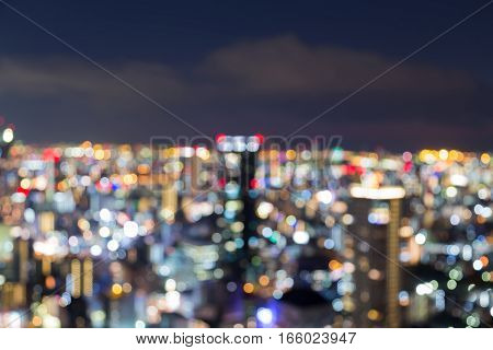Night blurred lights Osaka city office building downtown Japan