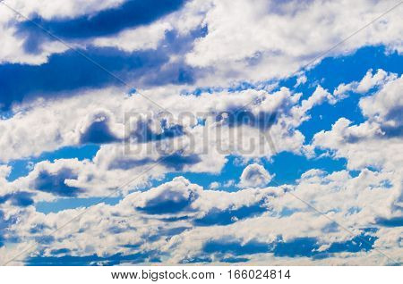 White fluffy cumulus clouds with blue sky