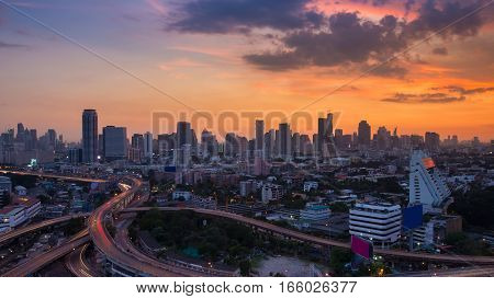 Sunset over city downtown skyline and highway intersection Bangkok Thailand