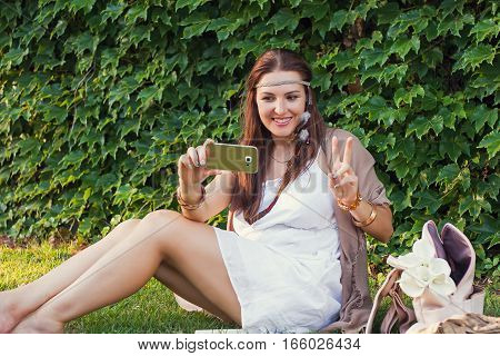 Young Woman, Green Wall; Plant, Boho Style, Mobile Device, Beauty, Emotions