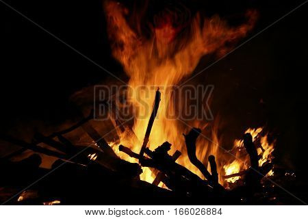 traditional bonfire of San Juan, witch figure out the flames, traditional bonfire on the Riazor beach and others towns of Galicia, Spanish festivals and tourist attractions, eating, fun,celebrations