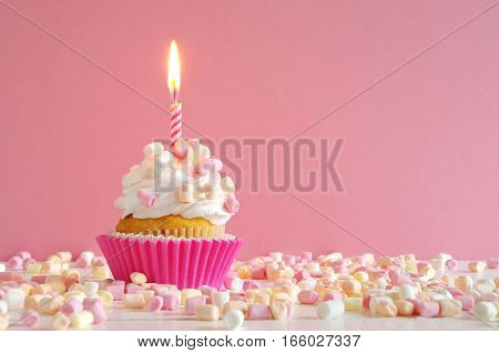 homemade birthday cake with whipping cream and marshmallow