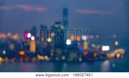 Blurred bokeh Hong Kong city over seacoast night view