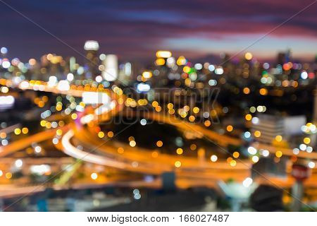 Blurred bokeh light city downtown interchanged with beautiful sky background