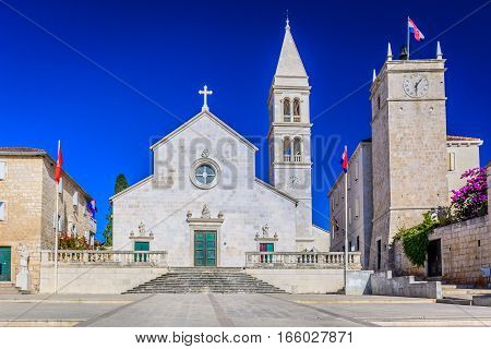 Historic old stone architecture of cathedral in Supetar, Island Brac, Croatia, european landmarks.