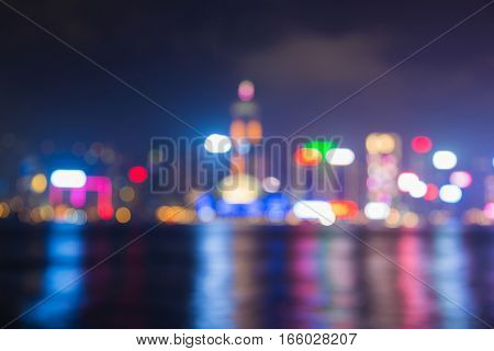 Hong Kong city blurred light with reflection over coastline abstract background