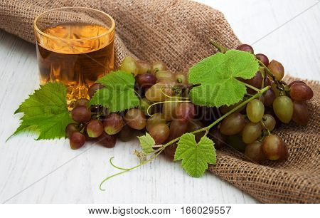 Glass With Wine And White Grape