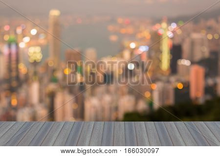 Opening wooden floor blurred bokeh lights Hong Kong city aerial view