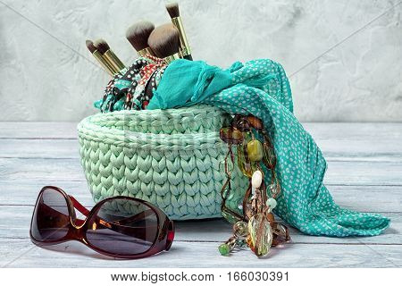 Knitted Baskets For Trivia With Brushes For Make-up, Scarf And Bead With Sunglasses. Woman Lifestyle